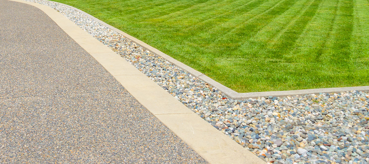 An Attentively-Trimmed Lawn and Driveway